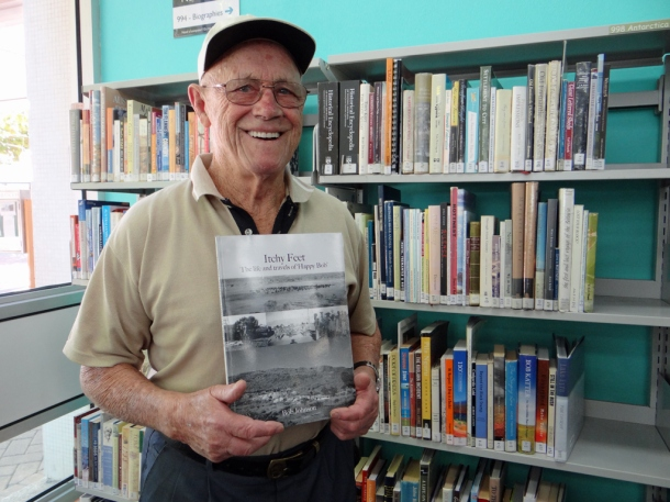 Bob Johnson holding a copy of his book